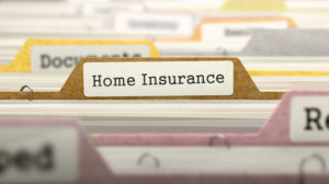 File Folder Labeled as Home Insurance in Multicolor Archive. Closeup View. Blurred Image.